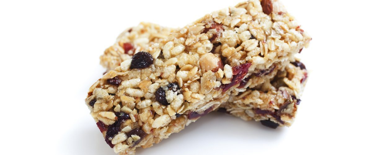 A photo of an energy bar with dried fruit and oats