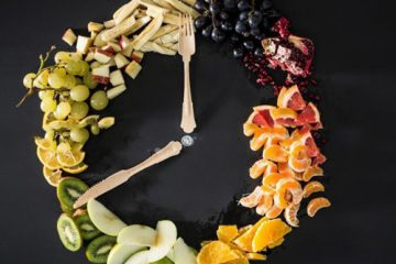 Assorted sliced fruit including grapes, apples, bananas and kiwi
