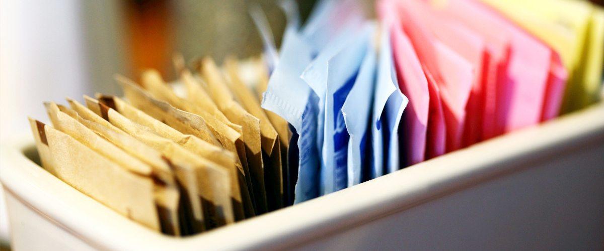 An assortment of artificial sweetener packets