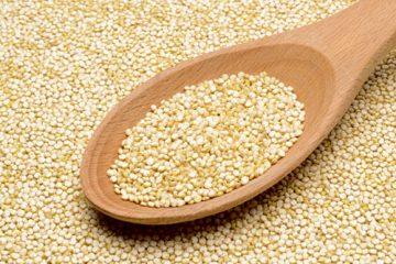 Wooden spoon atop grains