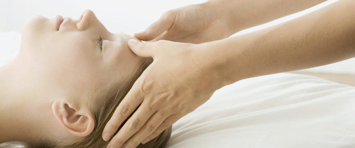 A woman receiving a head massage