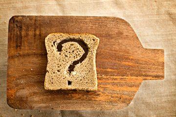 A piece of bread on a cutting board