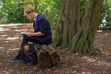 Nom Bar sketching beside a tree