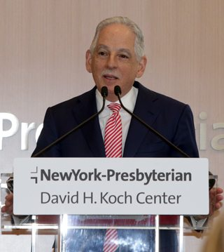 Dr. Steven J. Corwin, president and CEO of NewYork-Presbyterian, speaks about the center at a podium