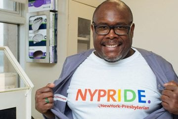 Portrait of Nuclear Pharmacist Corey Craig displaying his NYPRIDE t-shirt