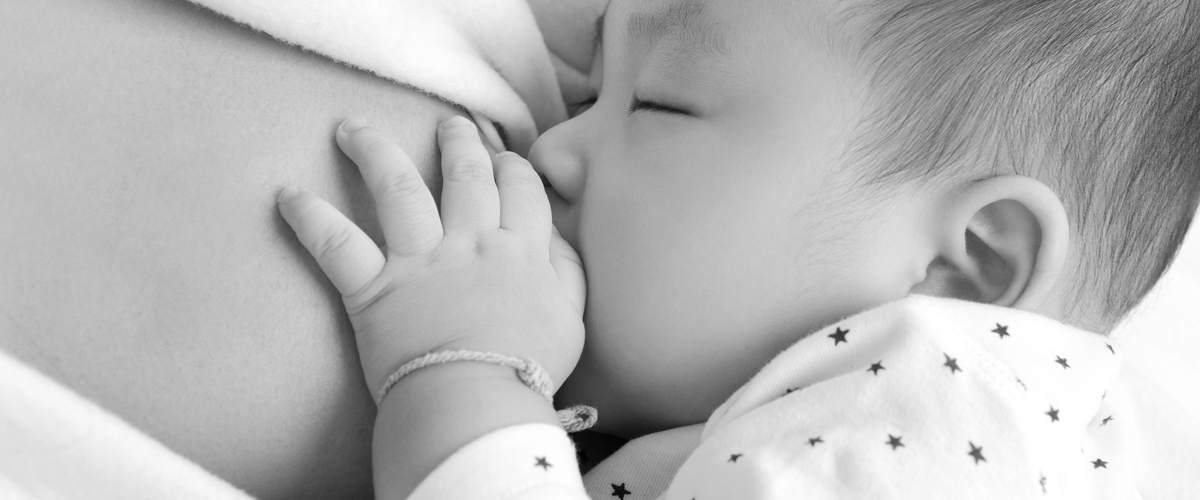 Mother breastfeeding an infant