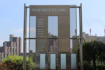 """A memorial with the words """"Inspired to Care"""""""