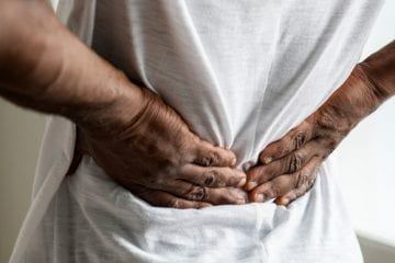 A man grasping his lower back