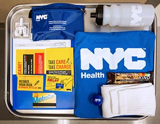 A NYC Health Department care bag that includes two naloxone nasal sprays, among other helpful items