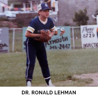 Dr. Ronald Lehman playing baseball as a child