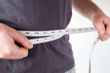 Man measuring waist