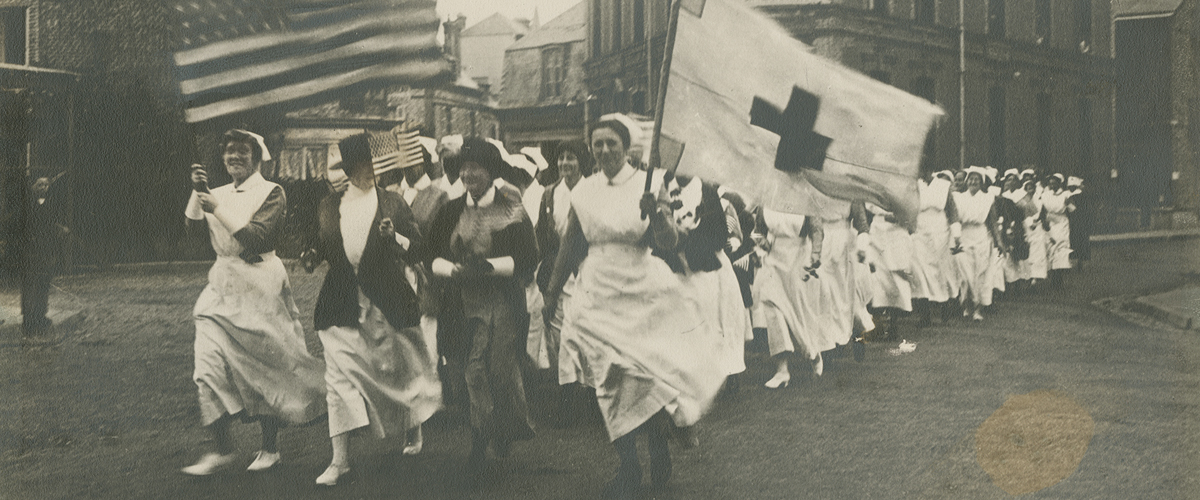 1918 photograph of a parade of Base Hospital No. 2 nurses escorting Anna Maxwell.