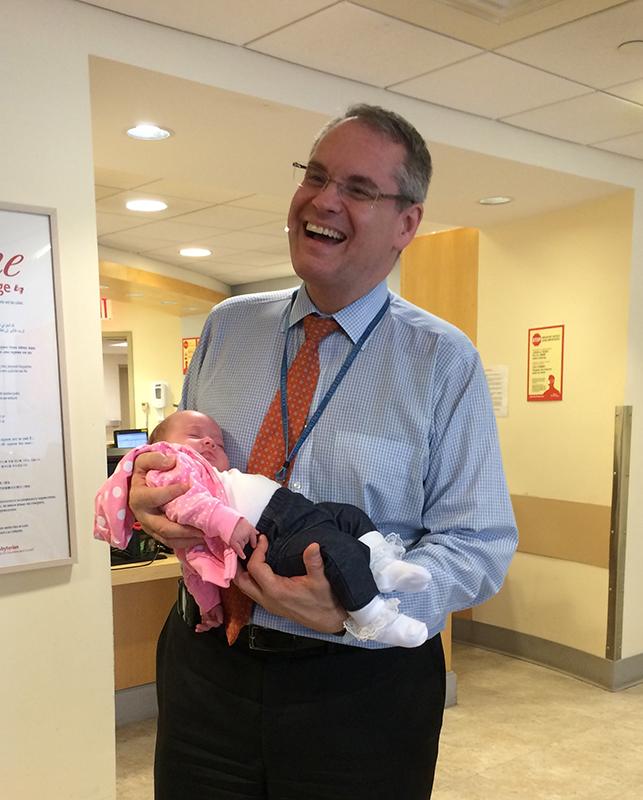 Dr. Jurcic holding Emma.
