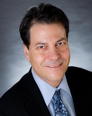 Headshot of Dr. Elkind