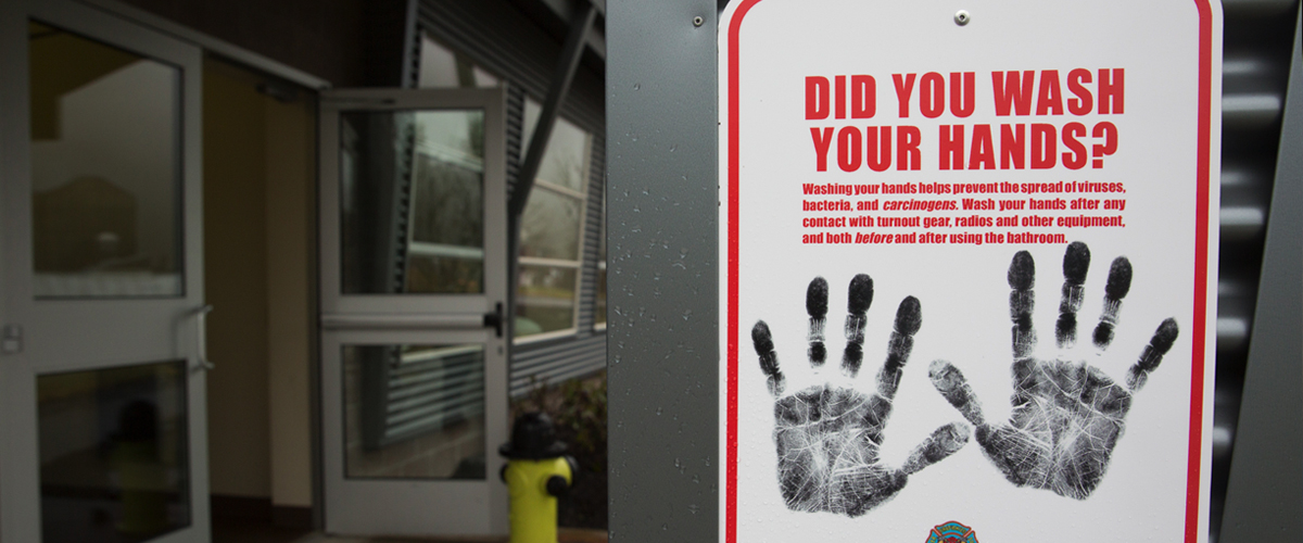 A sign reminding people to wash their hands