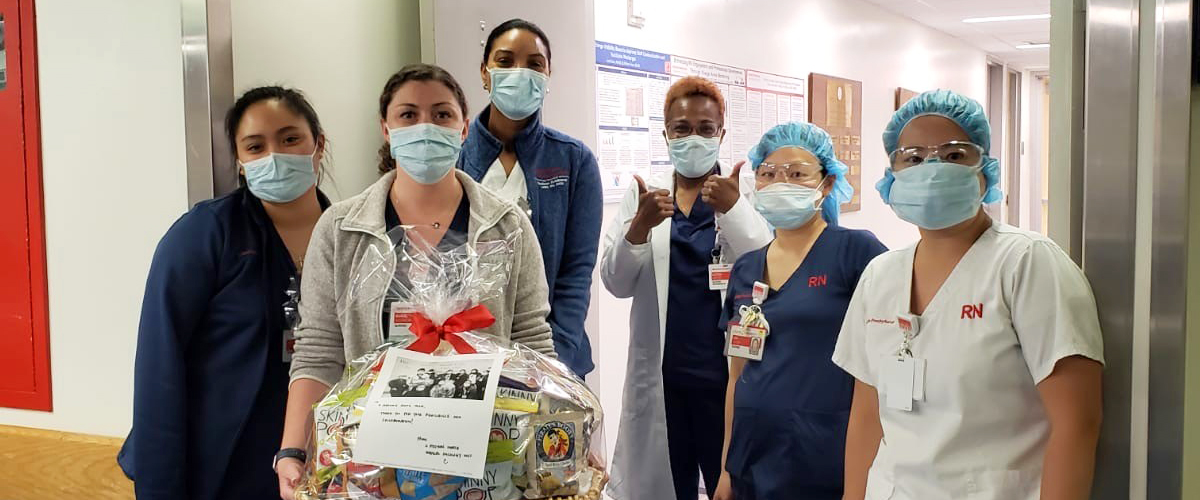 Group of NYP nurses on the front lines with a gift basket.