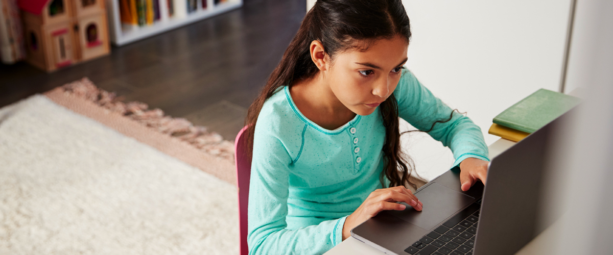 girl on laptop, on of many children experiencing increased scree time during the COVID-19 outbreak