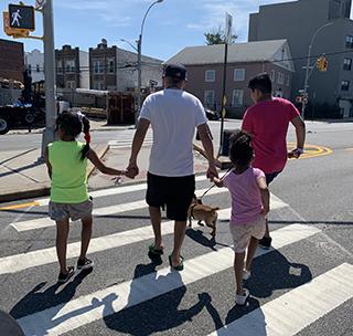 Agustin Tlathuetl and his family on a walk