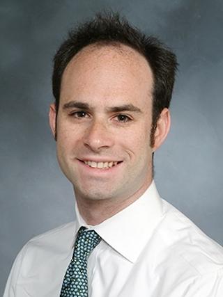 Headshot of Dr. Alexander Merkler