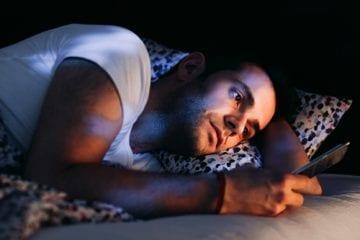 man suffering from coronasomnia