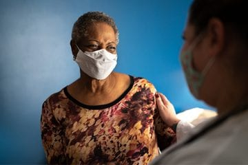 black woman seeing doctor about colorectal health