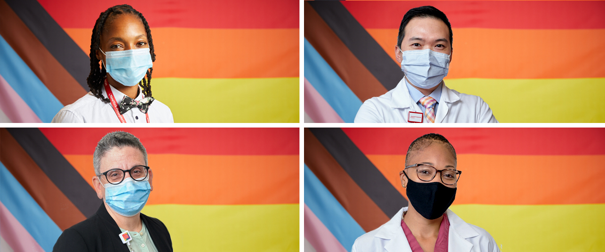 Healthcare workers standing in front of Pride Progress flag to celebrate Pride Month.