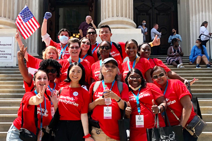 NYP staff celebrating on steps in front of city hall