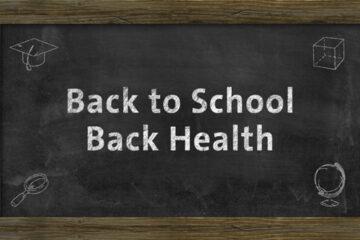 Chalk board with Back to School Back Health written on it.