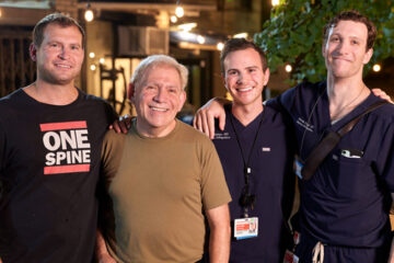 Henry Ray with three doctors who saved his life after suffering a heart attack on stage